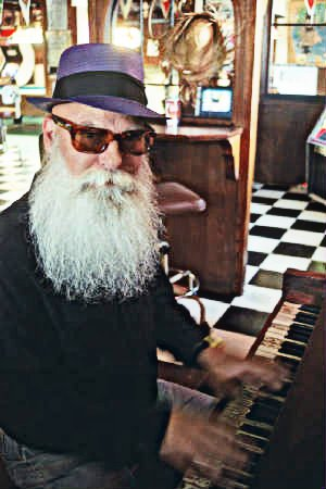Behind that glorious beard and wicked hat lies the musical genius of blues brotha' Raymond Vic.